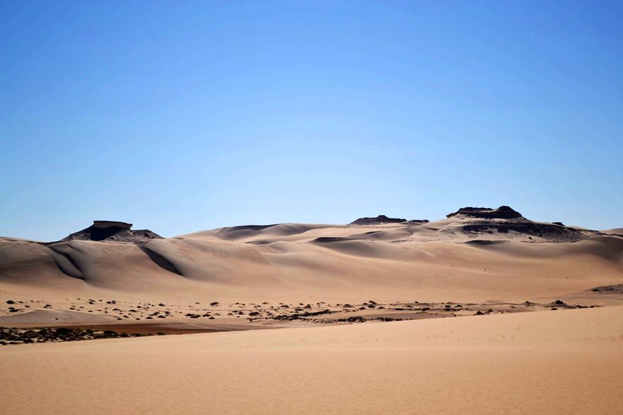 This September 2012 photo shows The Great Sand Sea, 28,000 square miles of rolling dunes along the northern edge of the Sahara, one of the main attractions of a visit to the Egyptian oasis of Siwa, a Berber town of some 27,000 people roughly 450 miles (about 725 kilometers) southwest of Cairo. The palm tree-lined area is known for its quiet charm, ancient ruins, abundant natural springs, a vast salt lake and rolling sand dunes in the surrounding desert. (AP Photo/Kim Gamel)