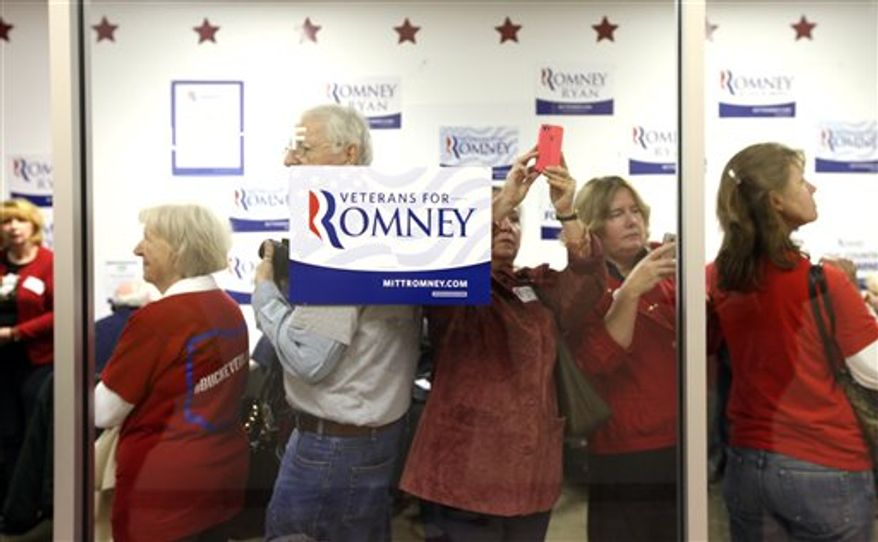 Fans and volunteers await the arrival of Ann Romney, wife of Republican presidential candidate Mitt Romney, at the Romney for Ohio Headquarters in Grandview Heights, Ohio on Wednesday, Oct. 31, 2012. (AP Photo/Columbus Dispatch, Brooke LaValley)