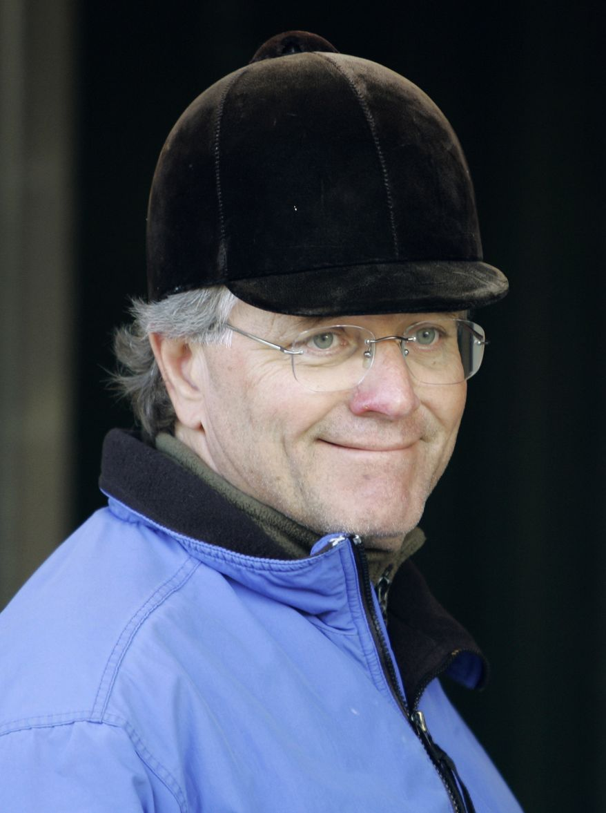 FILE - In this April 27, 2008, file photo, horse trainer Bill Mott smiles while waiting at his barn at Churchill Downs in Louisville, Ky. Mott is in position to duplicate the ultimate daily double. The Hall of Fame trainer swept the $2 million Ladies' Classic and $5 million Classic at last year's Breeders' Cup. He could do it again this weekend, with Royal Delta defending her Ladies' title and three of his horses running in the big race.   (AP Photo/Ed Reinke, File)