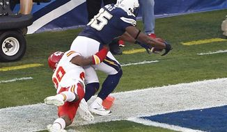 San Diego Chargers tight end Antonio Gates scores a touchdown as Kansas City Chiefs strong safety Eric Berry hangs on during the first quarter of an NFL game Thursday, Nov. 1, 2012, in San Diego. (AP Photo/Lenny Ignelzi)