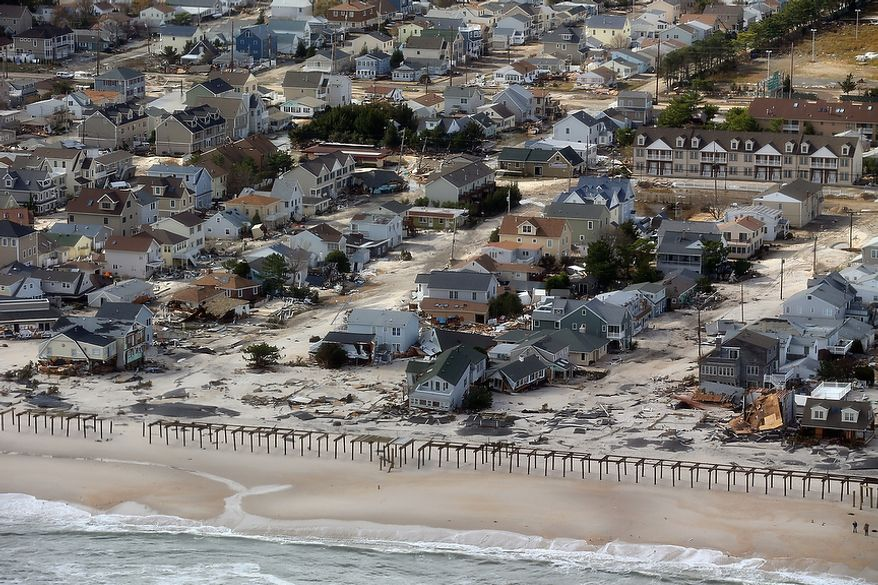 Storm damage along the Atlantic coast in Seaside Heights, N.J., is seen on Wednesday, Oct. 31, 2012, from a helicopter traveling behind the Marine One chopper carrying President Obama and New Jersey Gov. Chris Christie on an inspection tour. (AP Photo/Doug Mills, Pool)