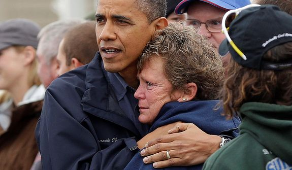 President Obama embraces Donna Vanzant during a tour of a neighborhood affected by superstorm Sandy, on Wednesday, Oct. 31, 2012, in Brigantine, N.J. Ms. Vanzant is an owner of North Point Marina, which was damaged by the storm. (AP Photo/Pablo Martinez Monsivais)