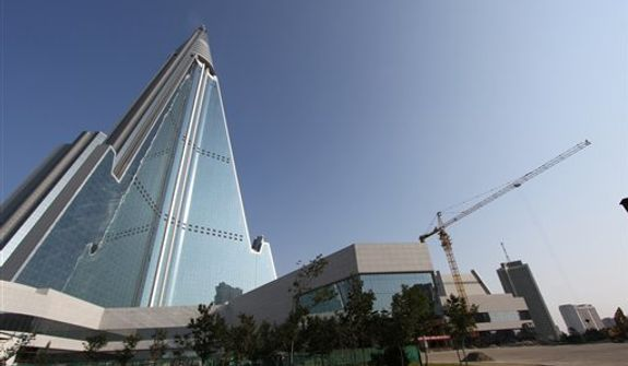 In this Sept. 23, 2012, photo released by Koryo Group on Wednesday, Sept. 26, 2012, the pyramid-shaped, 105-story Ryugyong Hotel stands in Pyongyang, North Korea. A foreign tour agency said the interior of the massive hotel in the North Korean capital remains unfinished. Beijing-based Koryo Tours got a sneak peek inside the hotel, which has been an off-limits construction site and remains a source of fascination for the outside world. (AP Photo/Koryo Group)