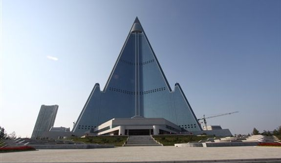 In this Sept. 23, 2012, photo released by Koryo Group on Wednesday, Sept. 26, 2012, the pyramid-shaped, 105-story Ryugyong Hotel stands in Pyongyang, North Korea. A foreign tour agency said the interior of the massive hotel in the North Korea capital remains unfinished. Beijing-based Koryo Tours got a sneak peek inside the hotel, which has been an off-limits construction site and remains a source of fascination for the outside world. (AP Photo/Koryo Group)