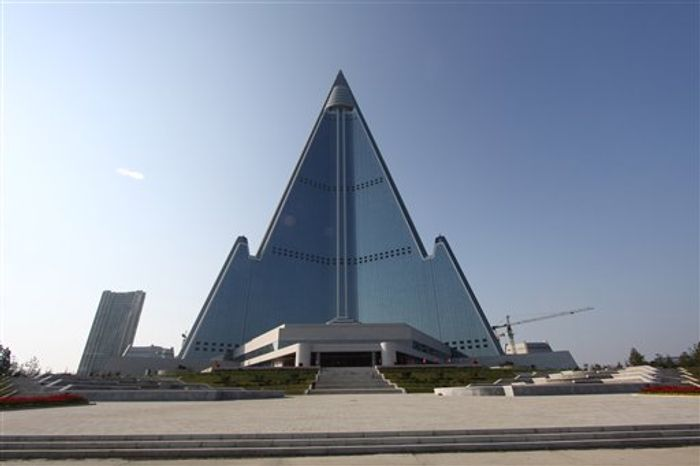 In this Sept. 23, 2012, photo released by Koryo Group on Wednesday, Sept. 26, 2012, the pyramid-shaped, 105-story Ryugyong Hotel stands in Pyongyang, North Korea. A foreign tour agency said the interior of the massive hotel in the North Korea capital remains unfinished. Beijing-based Koryo Tours got a sneak peek inside the hotel, which has been an off-limits construction site and remains a source of fascin