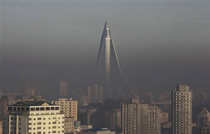 In this Oct. 26, 2011, photo, the 105-story Ryugyong Hotel towers above Pyongyang, North Korea. International hotel operator Kempinski AG said on Thursday, Nov. 1, 2012, that it will manage the pyramid-shaped hotel, which is expected to open next year with shops, offices, ballrooms, restaurants and 150 rooms. (AP Photo/Greg Baker)