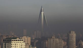 The 105-story, unfinished Ryugyong Hotel towers above Pyongyang, North Korea, in October 2011. (AP Photo/Greg Baker)