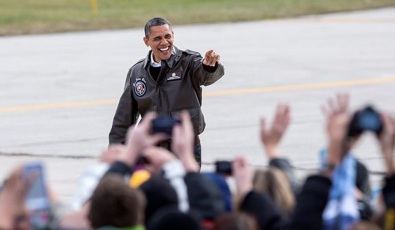 President Obama waves to supporters upon his arrival in Green Bay, Wis., on Thursday, Nov. 1, 2012, for a quick campaign stop before heading to Las Vegas. (AP Photo/Tom Lynn)