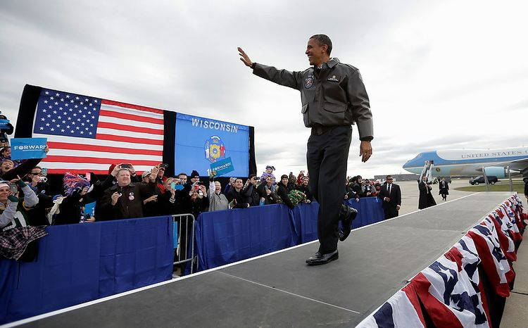 President Obama waves to supporters as he walks onstage for a campaign event at Austin Straubel International Airport in Green Bay, Wis., on Thursday, Nov. 1, 2012. Mr. Obama resumed his presidential campaign with