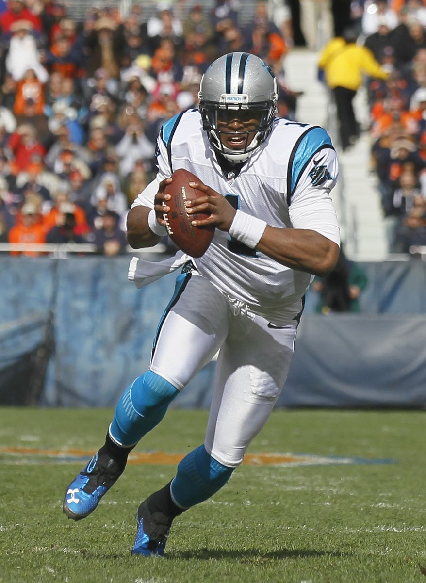 Carolina Panthers quarterback scrambles during the first half of an NFL football game against the Chicago Bears in Chicago, Sunday, Oct. 28, 2012. (AP Photo/Charles Rex Arbogast)