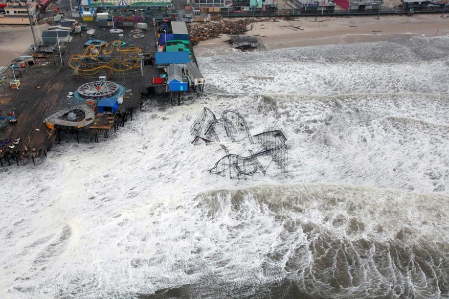 This Tuesday, Oct. 30, 2012, photo provided by the U.S. Air Force shows an aerial view of the roller coaster from the Seaside Heights amusement park on the New Jersey shore submerged in surf, taken during a search-and-rescue mission by 1-150 Assault Helicopter Battalion, New Jersey Army National Guard. (AP Photo/U.S. Air Force, Master Sgt. Mark C. Olsen)