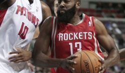 Houston Rockets guard James Harden (13) drives to the basket against Detroit Pistons center Greg Monroe (10) duringg the first half of an NBA basketball game Wednesday, Oct. 31, 2012, in Detroit. (AP Photo/Duane Burleson