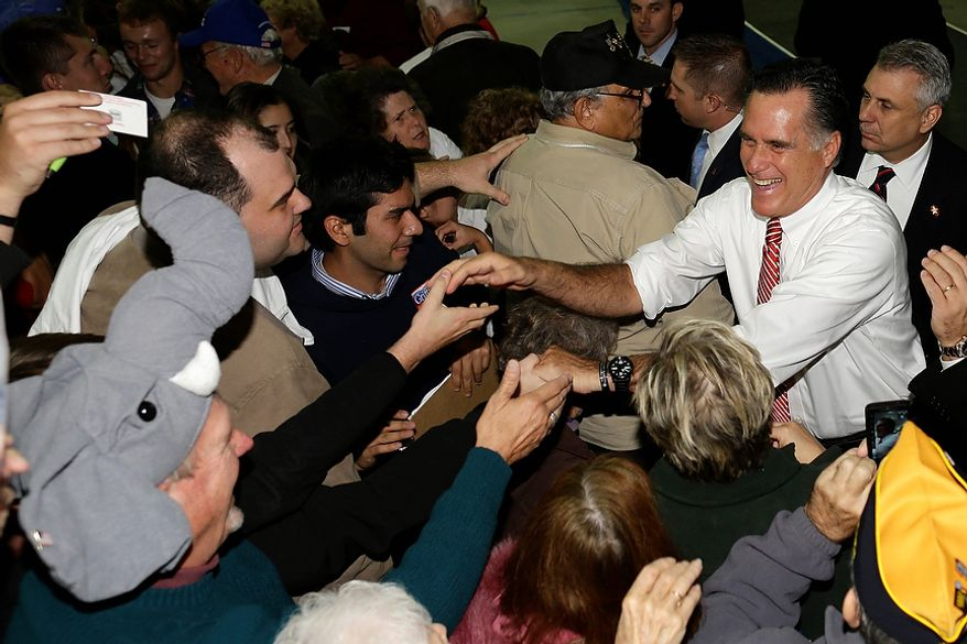 Republican presidential candidate, former Massachusetts Gov. Mitt Romney greets supporters, including one wearing an elephant hat, left, as he campaigns at Integrity Windows in Roanoke, Va., Thursday, Nov. 1, 2012. (AP Photo/Charles Dharapak)