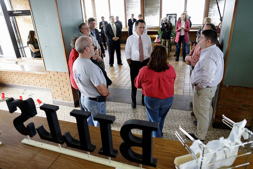 Republican presidential candidate, former Massachusetts Gov. Mitt Romney, accompanied by Virginia Republican Senate candidate George Allen, left, talks with Bill's Barbecue owner Rhoda Elliott, in red, back to camera, during s visit to the closed restaurant, before attending a campaign event in Richmond, Va., Thursday, Nov. 1, 2012. (AP Photo/Charles Dharapak)