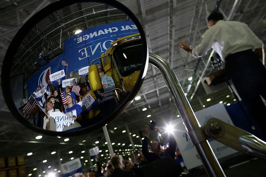 Supporters are reflected in a truck's mirror as Republican presidential candidate, former Massachusetts Gov. Mitt Romney campaigns at Integrity Windows in Roanoke, Va., Thursday, Nov. 1, 2012. (AP Photo/Charles Dharapak)