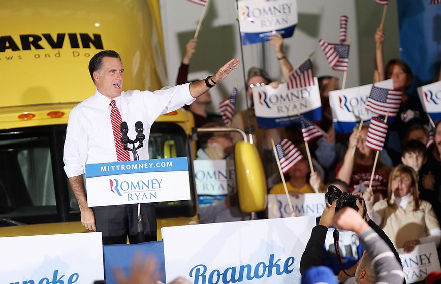 Republican presidential candidate, former Massachusetts Gov. Mitt Romney greets supporters at a campaign event at a window and door factory, Thursday, Nov. 1, 2012, in Roanoke, Va. (AP Photo/The Roanoke Times, Jeanna Duerscherl)