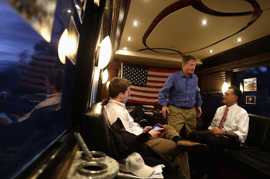 Republican presidential candidate and former Massachusetts Gov. Mitt Romney, chief strategist Stuart Stevens, center, and and aide Garrett Jackson are pictured on the campaign bus as they leave a campaign event at Meadow Event Park, in Dowell, Va., for another rally in Virginia Beach, Va., Thursday, Nov. 1, 2012. (AP Photo/Charles Dharapak)