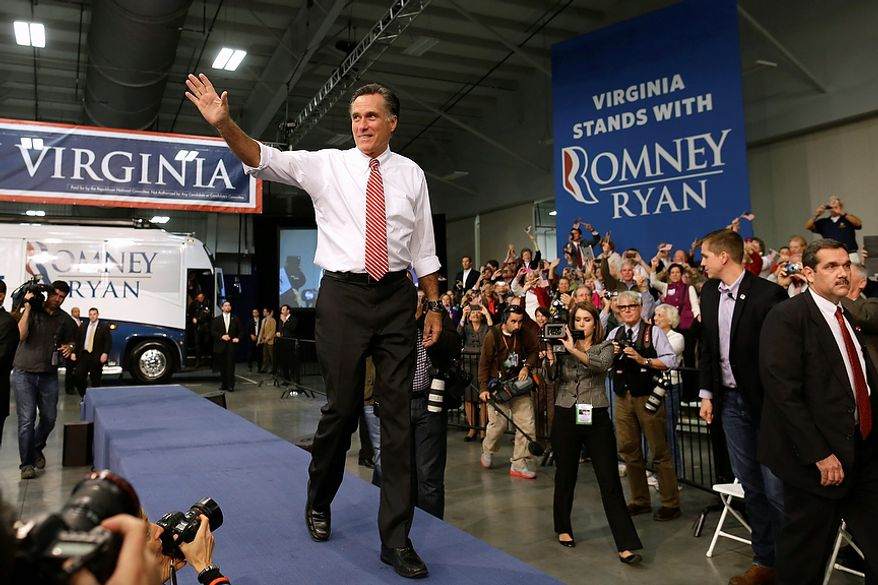 Republican presidential candidate, former Massachusetts Gov. Mitt Romney waves as he arrives on stage at a campaign stop at Meadow Event Park in Richmond, Va., Thursday, Nov. 1, 2012. (AP Photo/Charles Dharapak)