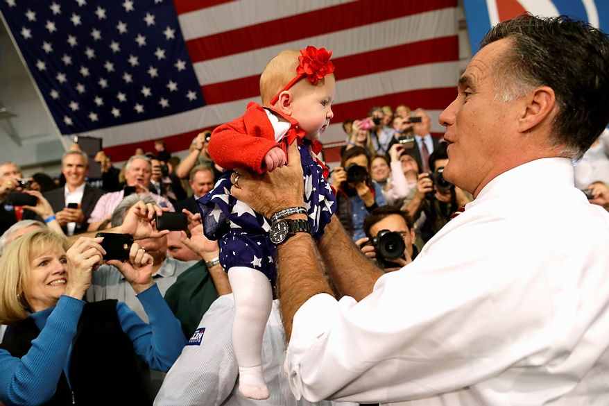 Republican presidential candidate, former Massachusetts Gov. Mitt Romney picks up a baby as he campaigns at Meadow Event Park, in Richmond, Va., Thursday, Nov. 1, 2012. (AP Photo/Charles Dharapak)