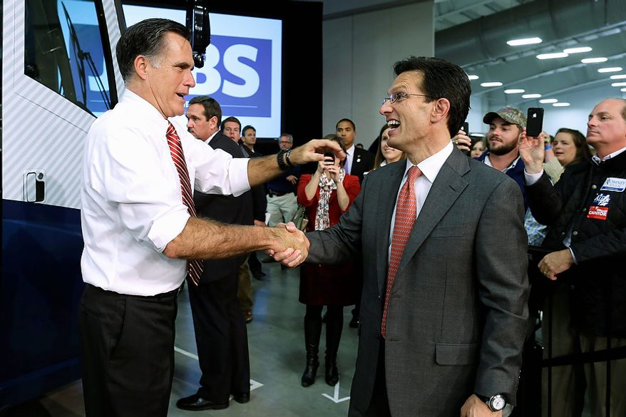 Republican presidential candidate, former Massachusetts Gov. Mitt Romney shakes hands with House Majority Leader Eric Cantor of Va. as he campaigns at Meadow Event Park, in Richmond, Va., Thursday, Nov. 1, 2012. (AP Photo/Charles Dharapak)
