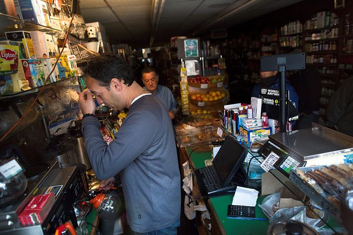 Manager Dean Pappas, 40, of Long Island, pauses as he makes coffee at The Open Pantry store on 12th Street that remains without power due to Superstorm Sandy, Friday, Nov. 2, 2012, in New York. In Manhattan, where 226,000 buildings, homes and business remain without p