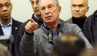 ** FILE ** Mayor Michael Bloomberg speaks to the media at Seward Park High School on the lower east side, the site of one of many public shelters set up in preparation of the storm, Sunday, Oct. 28, 2012, in New York. (AP Photo/ Louis Lanzano)