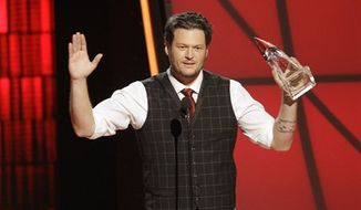 Blake Shelton accepts the award for entertainer of the year at the 46th Annual Country Music Awards at the Bridgestone Arena on Thursday, Nov. 1, 2012, in Nashville, Tenn. (Photo by Wade Payne/Invision/AP)