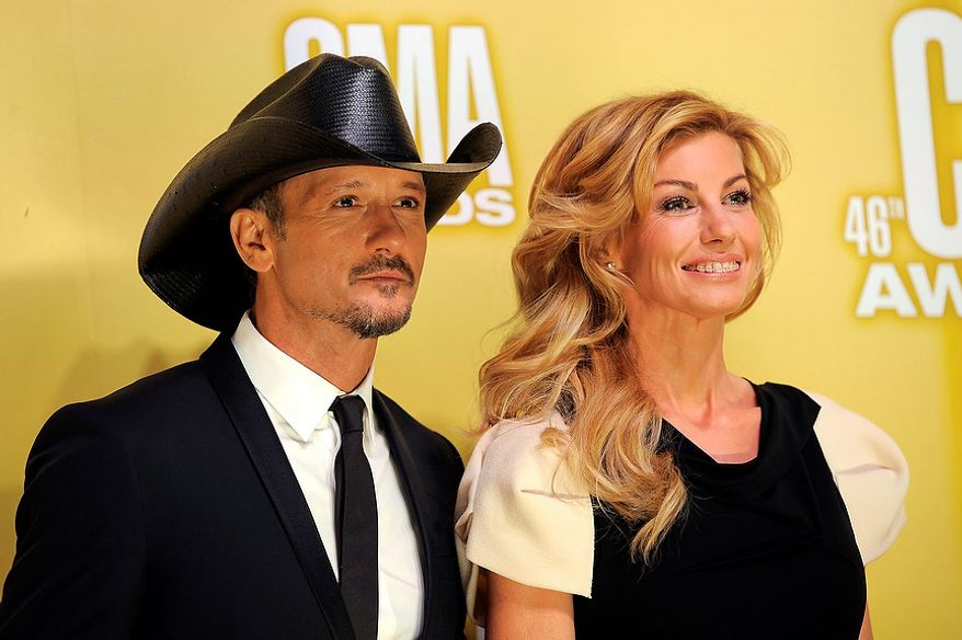 Tim McGraw, left, and Faith Hill arrive at the 46th Annual Country Music Awards at the Bridgestone Arena on Thursday, Nov. 1, 2012, in Nashville, Tenn. (Photo by Chris Pizzello/Invision/AP)