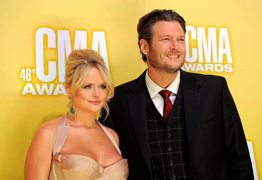 Miranda Lambert, left, and Blake Shelton arrive at the 46th Annual Country Music Awards at the Bridgestone Arena on Thursday, Nov. 1, 2012, in Nashville, Tenn. (Photo by Chris Pizzello/Invision/AP)