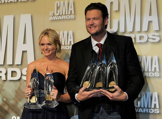 "Miranda Lambert, winner of the awards for song of the year for ""Over You"" and female vocalist of the year,  left, and Blake Shelton, winner of the awards for male vocalist of the year, song of the year for ""Over You"" and entertainer of the year, pose backstage at the 46th Annual Country Music Awards at the Bridgestone Arena on Thursday, Nov. 1, 2012, in Nashville,"