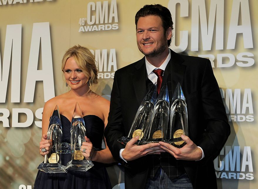 "Miranda Lambert, winner of the awards for song of the year for ""Over You"" and female vocalist of the year,  left, and Blake Shelton, winner of the awards for male vocalist of the year, song of the year for ""Over You"" and entertainer of the year, pose backstage at the 46th Annual Country Music Awards at the Bridgestone Arena on Thursday, Nov. 1, 2012, in Nashville, Tenn. (Photo by Chris Pizzello/Invision/AP)"