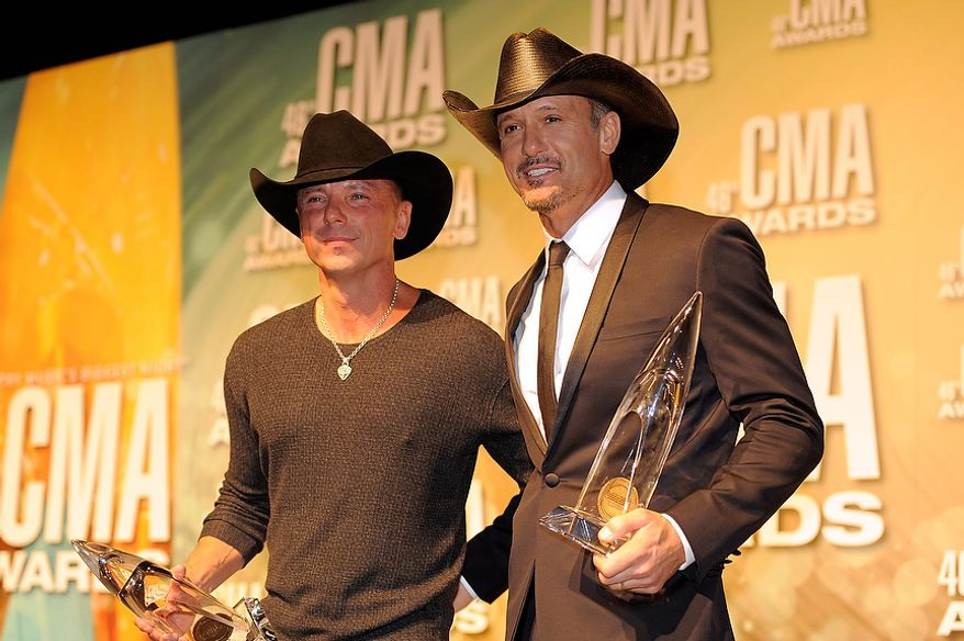 Kenny Chesney, left, and Tim McGraw pose backstage with their awards for musical event of the year at the 46th Annual Country Music Awards at the Bridgestone Arena on Thursday, Nov. 1, 2012, in Nashville, Tenn. (Photo by Chris Pizzello/Invision/AP)