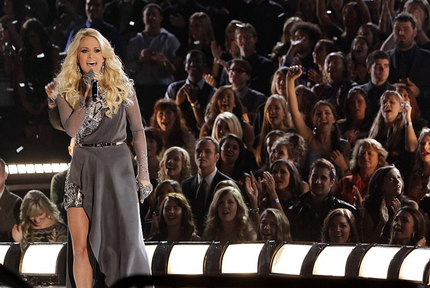 Carrie Underwood performs onstage at the 46th Annual Country Music Awards at the Bridgestone Arena on Thursday, Nov. 1, 2012, in Nashville, Tenn. (Photo by Wade Payne/Invision/AP)