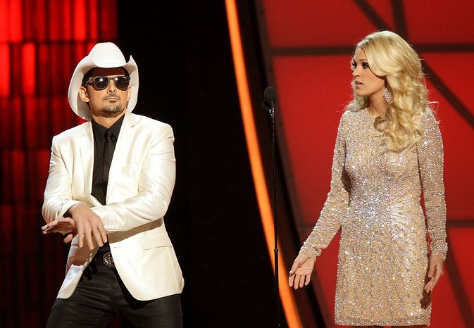 Hosts Brad Paisley, left, and Carrie Underwood dance onstage at the 46th Annual Country Music Awards at the Bridgestone Arena on Thursday, Nov. 1, 2012, in Nashville, Tenn. (Photo by Wayde Payne/Invision/AP)