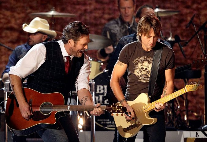 Blake Shelton, left, and Keith Urban perform during a tribute to Willie Nelson at the 46th Annual Country Music Awards at the Bridgestone Arena on Thursday, Nov. 1, 2012, in Nashville, Tenn. (Photo by Wade Payne/Invision/AP)