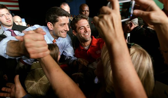 Republican vice presidential candidate, Rep. Paul Ryan, R-Wis., poses for a photograph with a supporter during a campaign event, Thursday, Nov. 1, 2012 in Reno, Nev.  (AP Photo/Mary Altaffer)