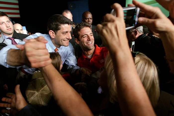 Republican vice presidential candidate, Rep. Paul Ryan, R-Wis., poses for a photograph with a supporter during a campaign event, Thursday, Nov. 1, 2012 in Reno, Nev.  (AP