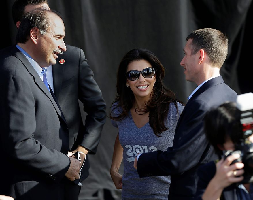 Actress and Obama supporter Eva Longoria, center, talks with Obama Senior campaign adviser David Axelrod, left, and White House senior adviser David Plouffe, right, during a campaign event at Cheyenne Sports Complex in Las Vegas, Thursday, Nov. 1, 2012. (AP Photo/Pablo Martinez Monsivais)
