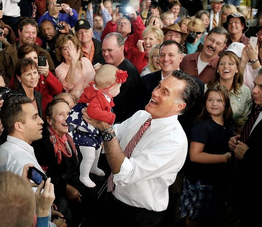 Republican presidential candidate and former Massachusetts Gov. Mitt Romney holds up 5 month-old Charlotte McGee from Maryland after speaking at the campaign event at Meadow Farm Park, Thursday, Nov. 1, 2012 in Doswell, Va. (AP Photo/ Richmond Times-Dispatch, Dean