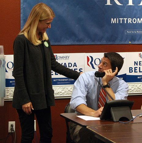 Republican vice presidential candidate Paul Ryan looks up at his wife Janna as he mans the phones at the Team Nevada headquarters in Las Vegas, Nov. 1, 2012. (AP Photo/Las Vegas Review-Journal, Jerr