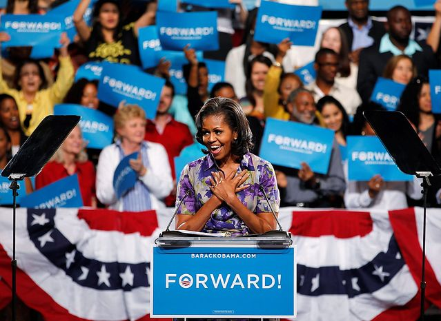 First lady Michelle Obama gestures as she speaks to supporters at a campaign event at the James L. Knight Center, Thursday, Nov. 1, 2012 in Miami. (AP Photo/Wilfredo Lee)