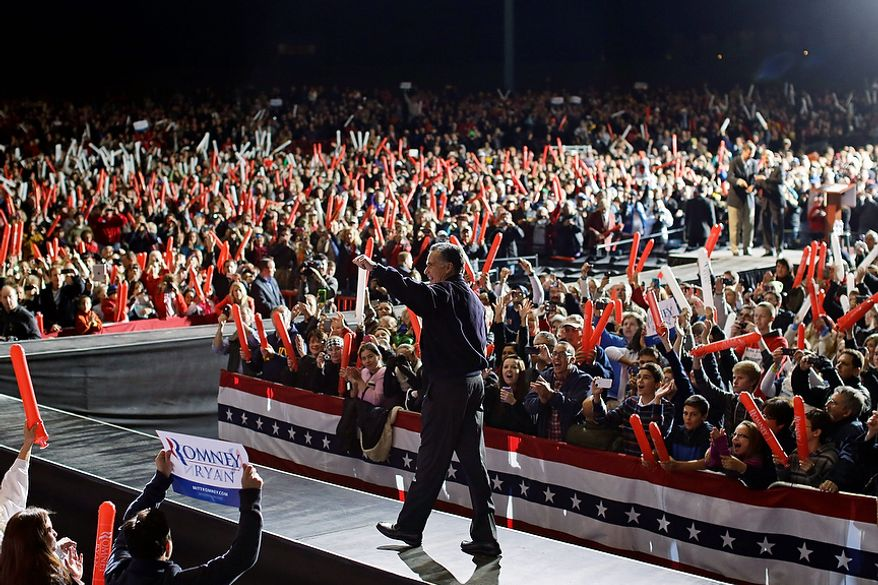 Republican presidential candidate and former Massachusetts Gov. Mitt Romney arrives on stage to campaign at Farm Bureau Live at Virginia Beach, Va.,Thursday, Nov. 1, 2012. (AP Photo/Charles Dharapak)