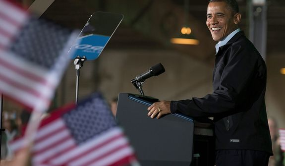 President Barack Obama smile as he speaks at a campaign event at the Franklin County Fairgrounds, Friday, Nov. 2, 2012, in Hilliard, Ohio, before heading to another campaign stop in in Springfield, Ohio. (AP Photo/Carolyn Kaster)