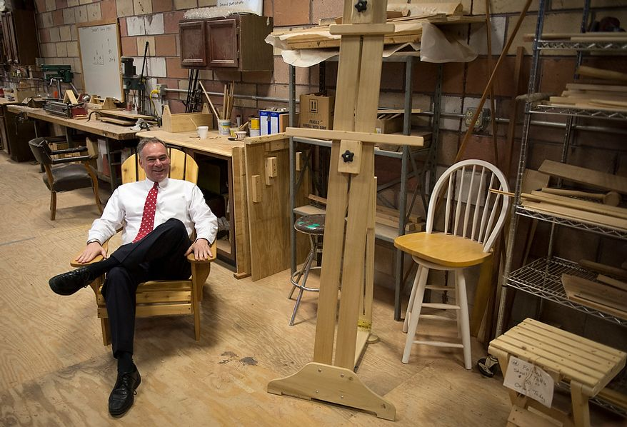 Democratic U.S. Senate candidate and former Virginia Governor Tim Kaine sits in an Adirondack chair built by apprentices, as he takes a tour of the Alexandria Seaport Foundation in Alexandria, Va., Thursday, Nov. 1, 2012. The Alexandria Seaport Foundation is a ship building apprenticeship program for at-risk youths on the waterfront in Old Town, Alexandria, Va. (Rod Lamkey Jr./The Washington Times)