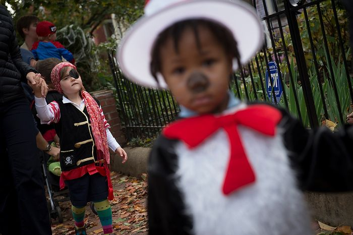Rebecca Heim, 3, (left) and Nehemiah Mills, 3, both from Washington, D.C., join other kids from the AppleTree Early Learning Public Charter School Lincoln Park Campus for their Halloween parade in Washington, D.C., Wednesday, Oct. 31, 2012. (Rod Lamkey Jr./The Washington Times)