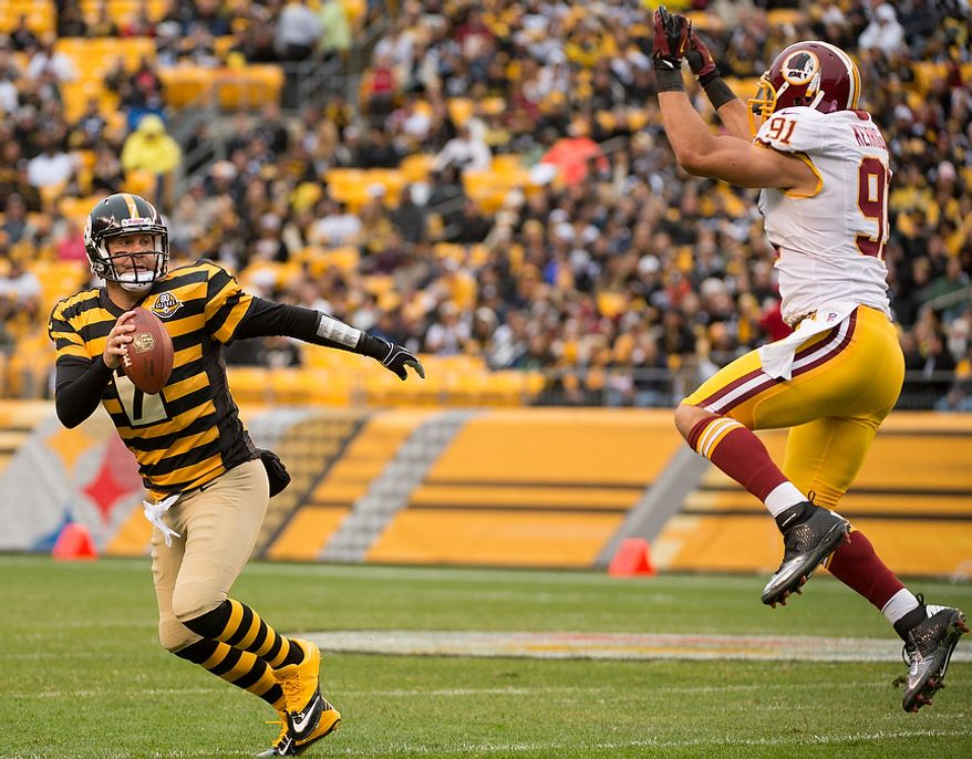 Pittsburgh Steelers quarterback Ben Roethlisberger (7) scrabbles as Washington Redskins outside linebacker Ryan Kerrigan (91) closes in in the first quarter as the Washington Redskins take on the Pittsburgh Steelers at Heinz Field, Pittsburgh, Pa., Sunday, October 28, 2012. (Andrew Harnik/The Washington Times)