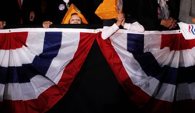 Luke Frank, 6, and his brother Zachary, 8, right, from Grafton, Wis., wearing Romney cheeshead hats, listen as Republican presidential candidate, former Massachusetts Gov. Mitt Romney campaigns at the Wisconsin Products Pavilion at State Fair Park in West Allis, Wis., Friday, Nov. 2, 2012. (AP Photo/Charles Dharapak)