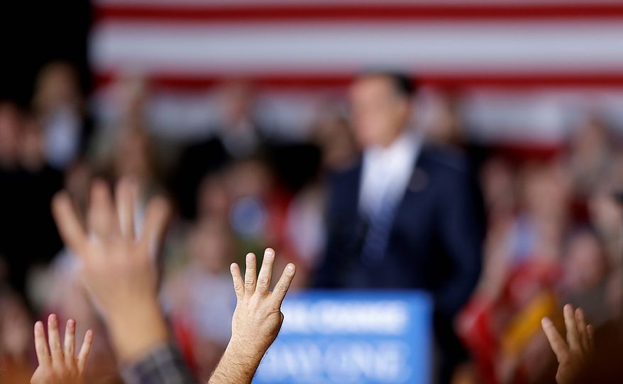 """Supporters gesture as they chant """"four more days"""" in reference to the upcoming election as Republican presidential candidate, former Massachusetts Gov. Mitt Romney speaks at a campaign event at Wisconsin Products Pavilion at State Fair Park, Friday, Nov. 2, 2012, in West Allis, Wis. (AP Photo/David Goldman)"""