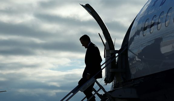 A silhouetted Republican presidential candidate, former Massachusetts Gov. Mitt Romney steps off his campaign plane at General Mitchell International Airport in Milwaukee, Wis., Friday, Nov. 2, 2012. (AP Photo/Charles Dharapak)