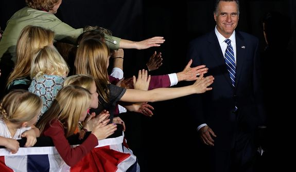 Supporters reach out to Republican presidential candidate, former Massachusetts Gov. Mitt Romney as he arrives to campaign stop at the Wisconsin Products Pavilion at State Fair Park in West Allis, Wis., Friday, Nov. 2, 2012. (AP Photo/Charles Dharapak)